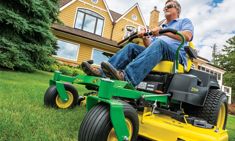 Man riding Residential ZTrak™ Mower.