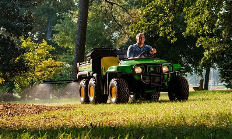 Man driving a Gator Traditional Utility Vehicle
