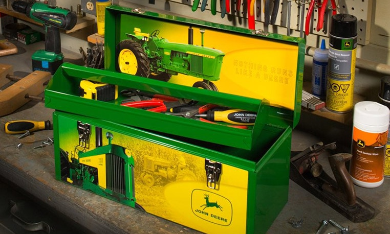 A John Deere tool box with John Deere tools sits on a workbench