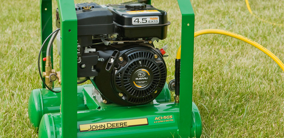 AC1-5GS Gasoline Air Compressor on a lawn