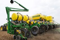 John Deere drawn planter working in the field
