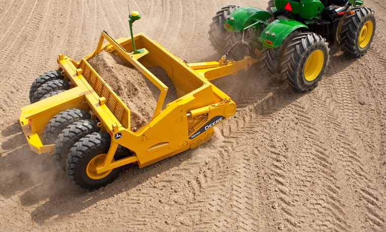 Overhead view of a John Deere Scraper working at a job site