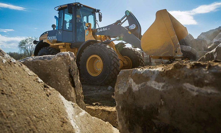 John Deere 544K-II Wheel Loader moves rock on a jobsite