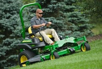 Man using a John Deere Commercial Mower