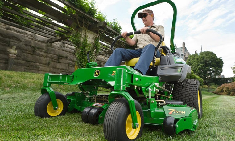 Man operates a ZTrak Z900 mower