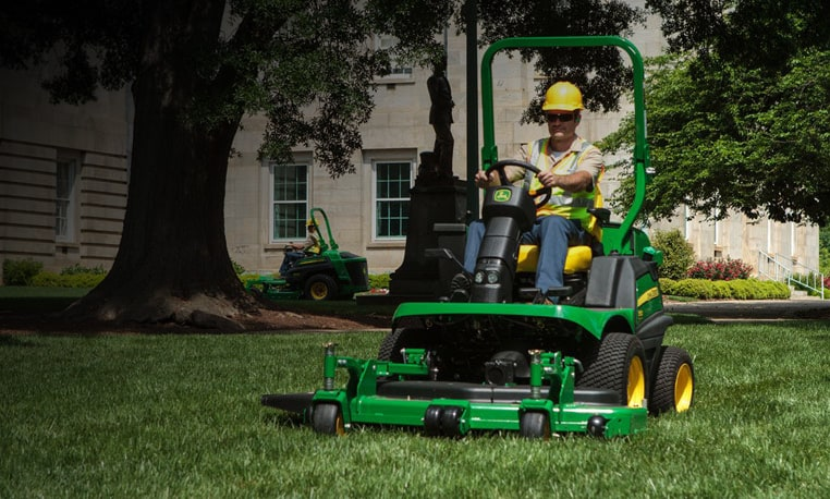 Man using a Front Mower to mow grass
