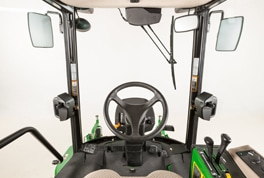 Front mower outside cab