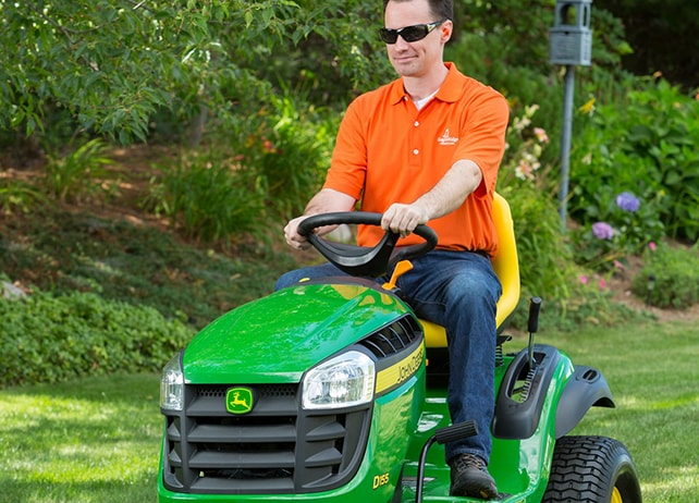 Man riding D155 lawn tractor