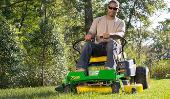 Man riding EZtrak Zero-turn Mower