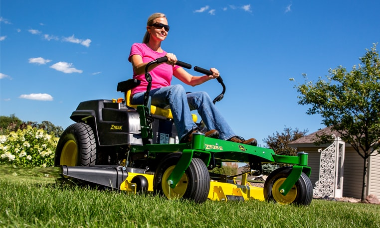 Woman riding ZTrak™ Z535E Mower.
