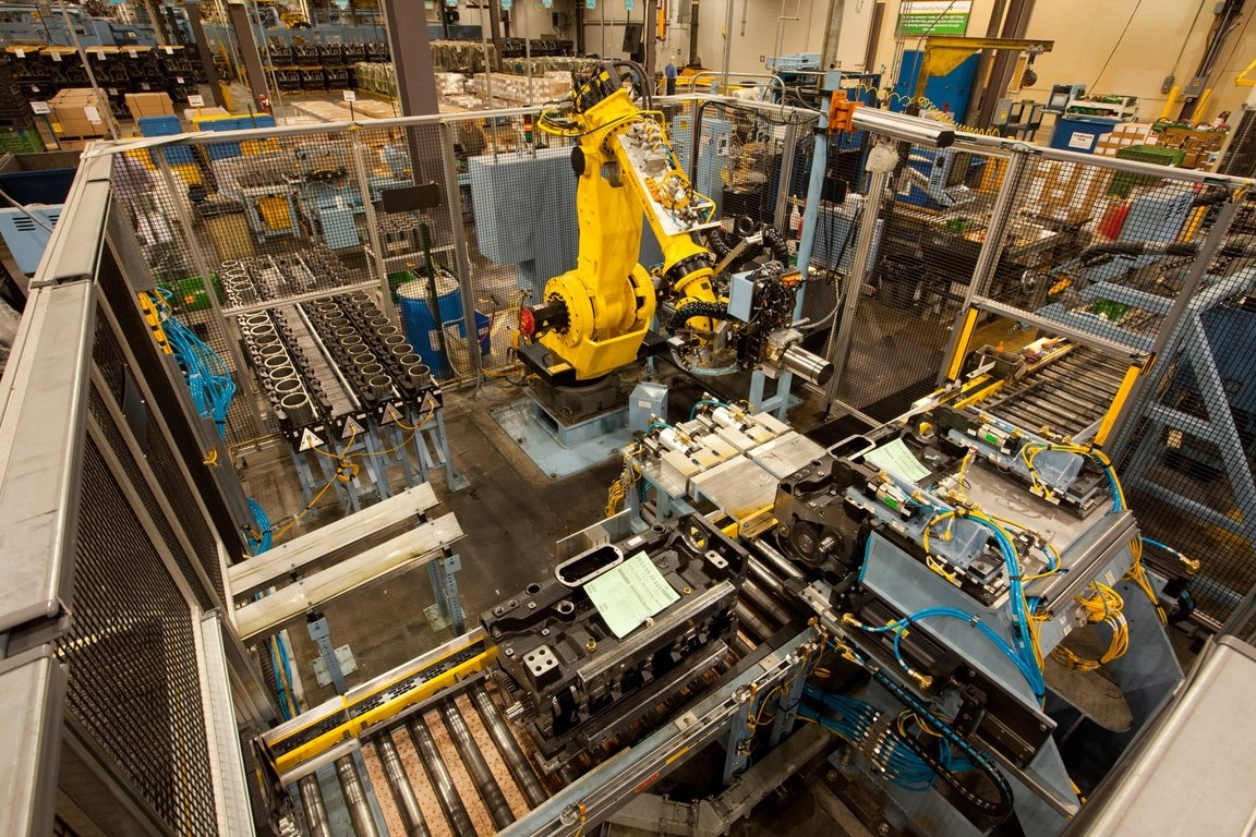 A robotic arm assists in the manufacturing process