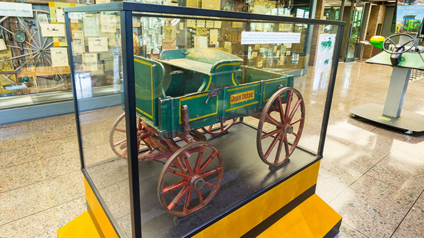 A piece of John Deere history sits inside a glass display case