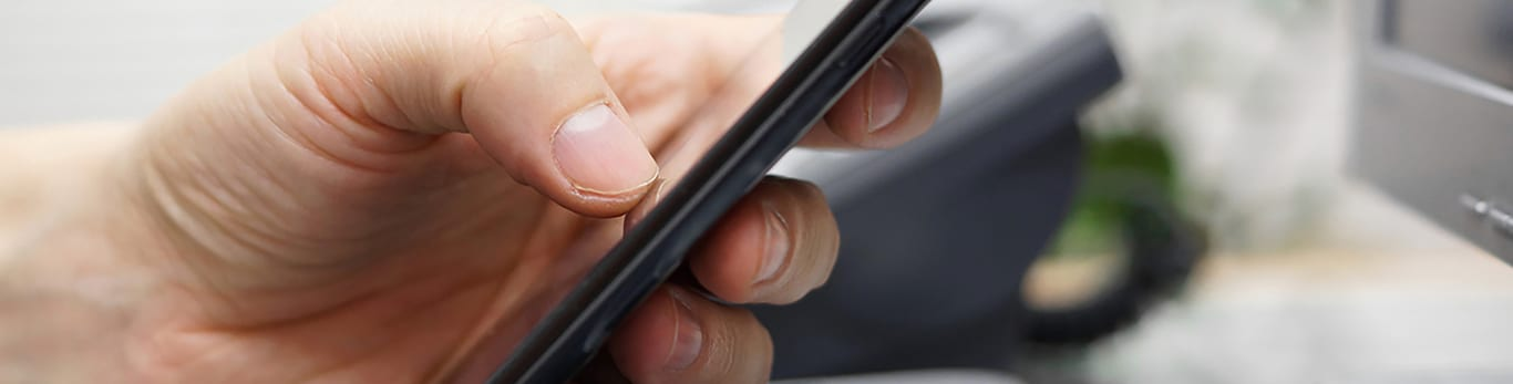 Image of hands using a mobile phone.