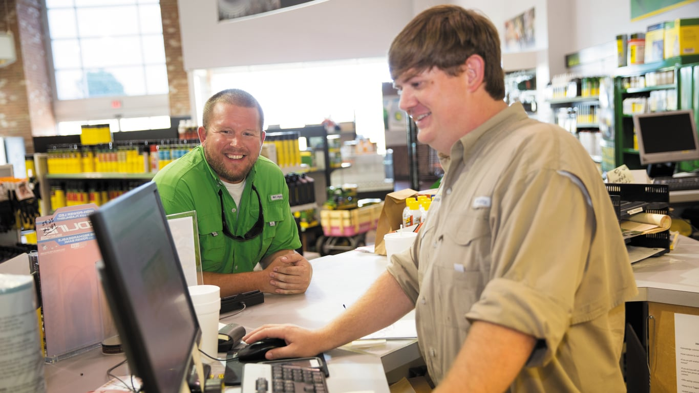 Customer and salesman talking at a John Deere Dealership