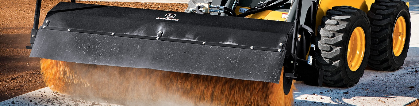 Close up of Broom Attachment on Compact Equipment