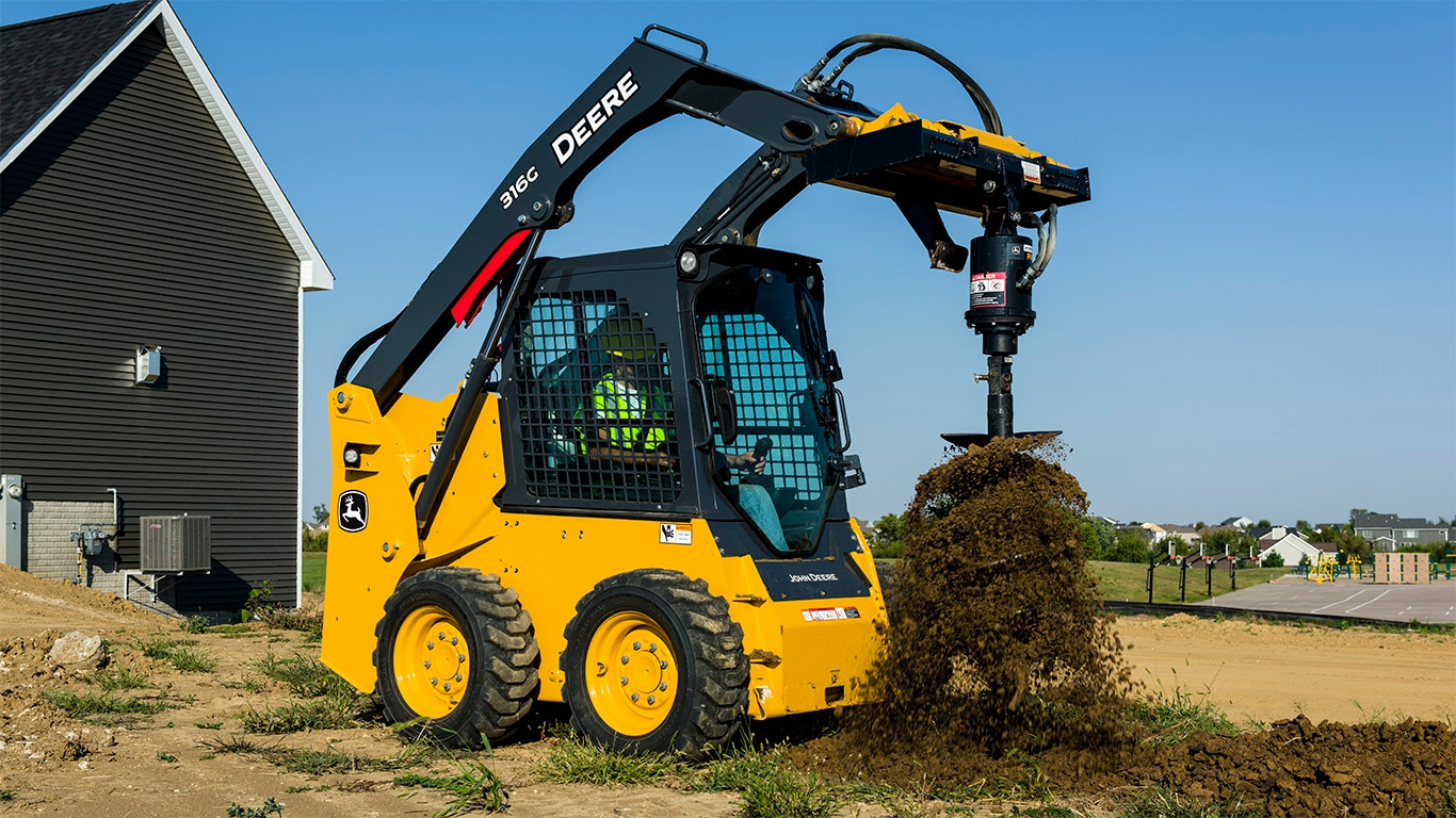 316G Skid Steer with Auger attachment digging a hole