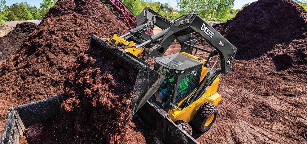 332G skid steer loading mulch