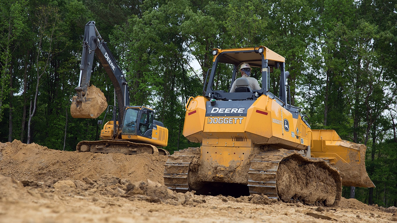An excavator and dozer working side by side on a construction site.