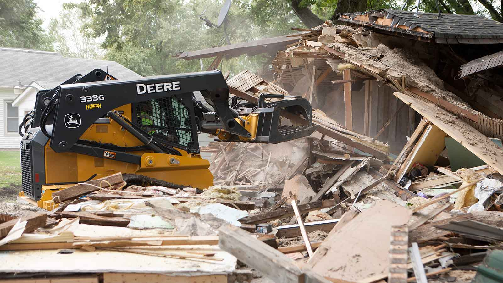 Moore uses the 333G compact track loader to demolish an old house.
