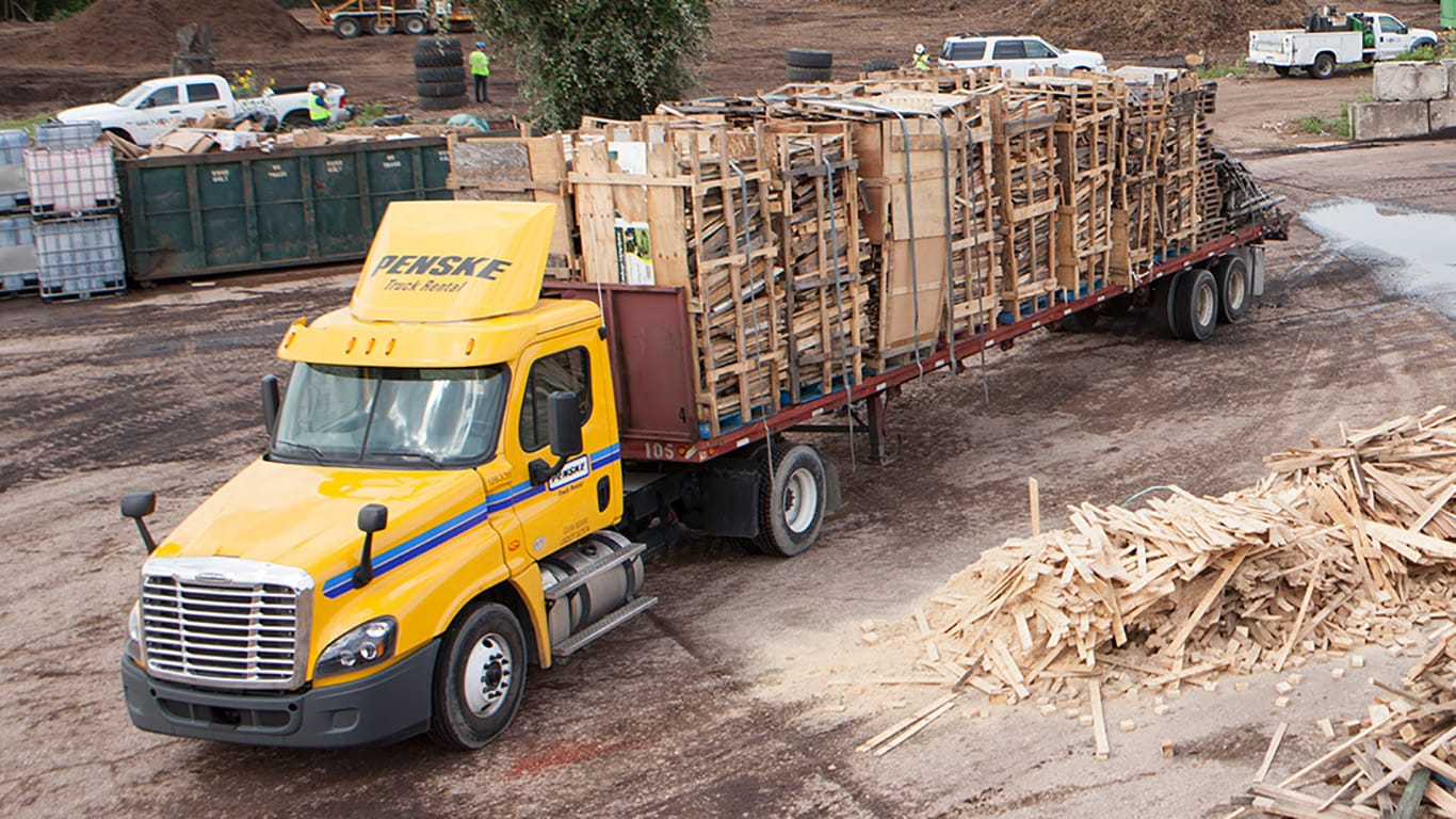 A truck is loaded with wood scraps