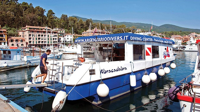 Abracadabra Dive Boat Powered by John Deere Marine Engine Docked in Tuscany Archipelago Harbor