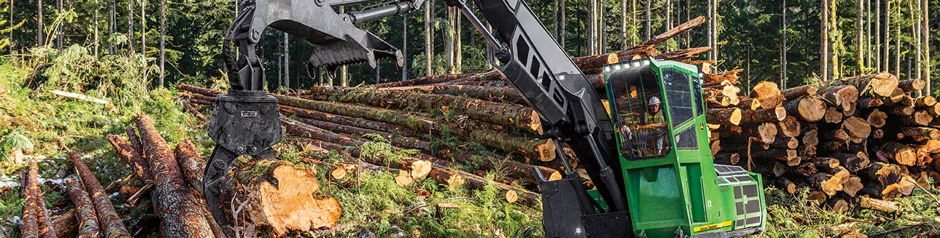 swing machine moving felled trees