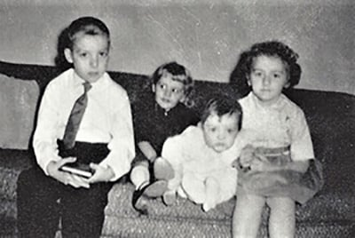 On the sofa, from left, are the Mack children Tom, Carol, Lori, and Connie.