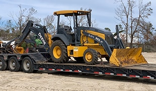 Dealer Provides Backhoes to Aid Hurricane Recovery