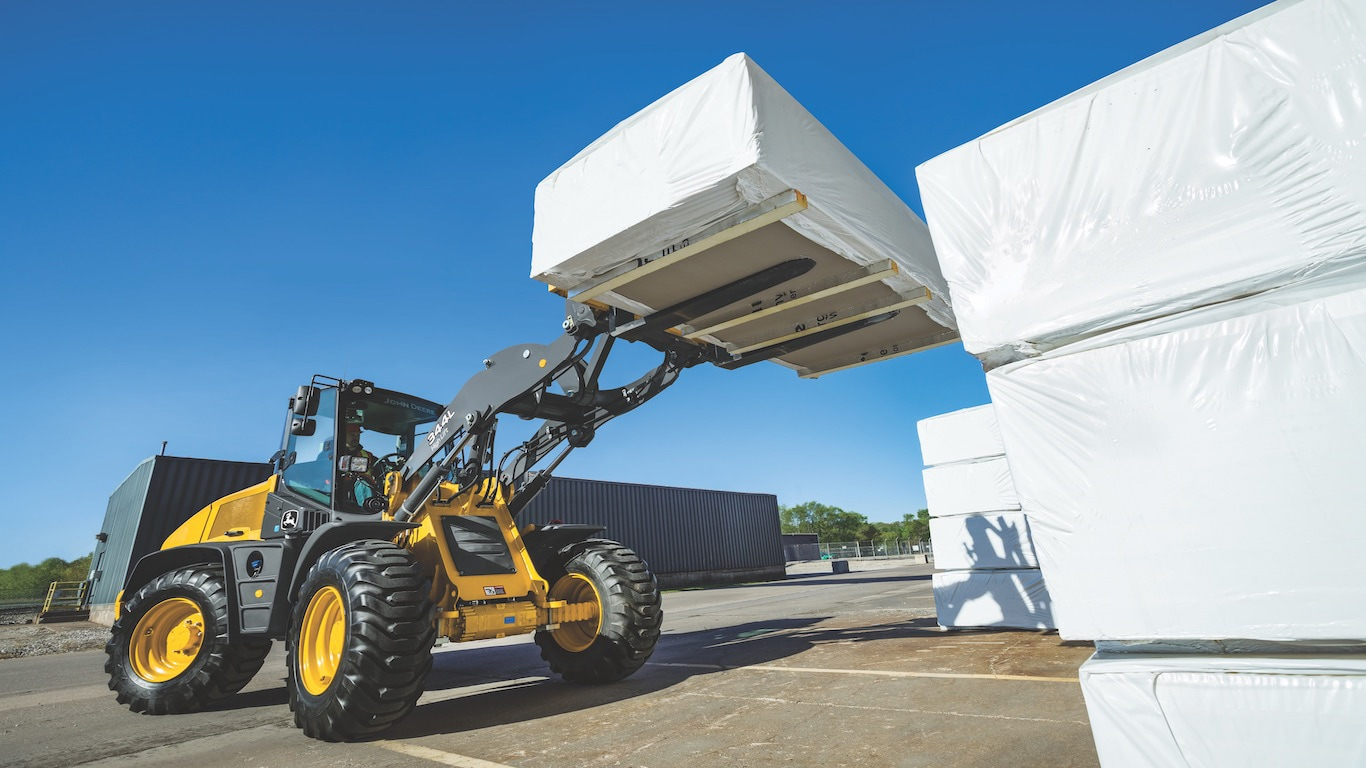 Side view of the 344L high-lift option extended on the 344L Compact Wheel Loader