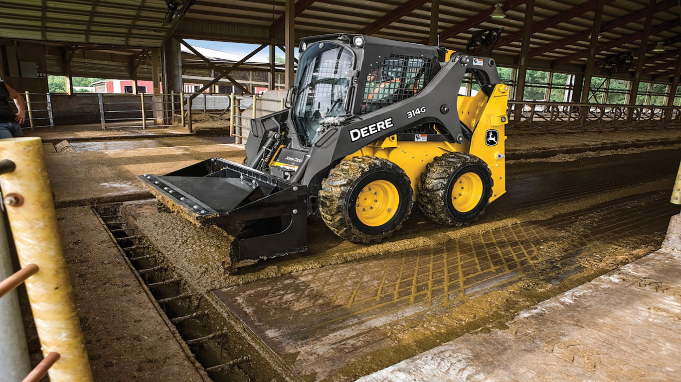 View of the 314G skid steer loader in action.