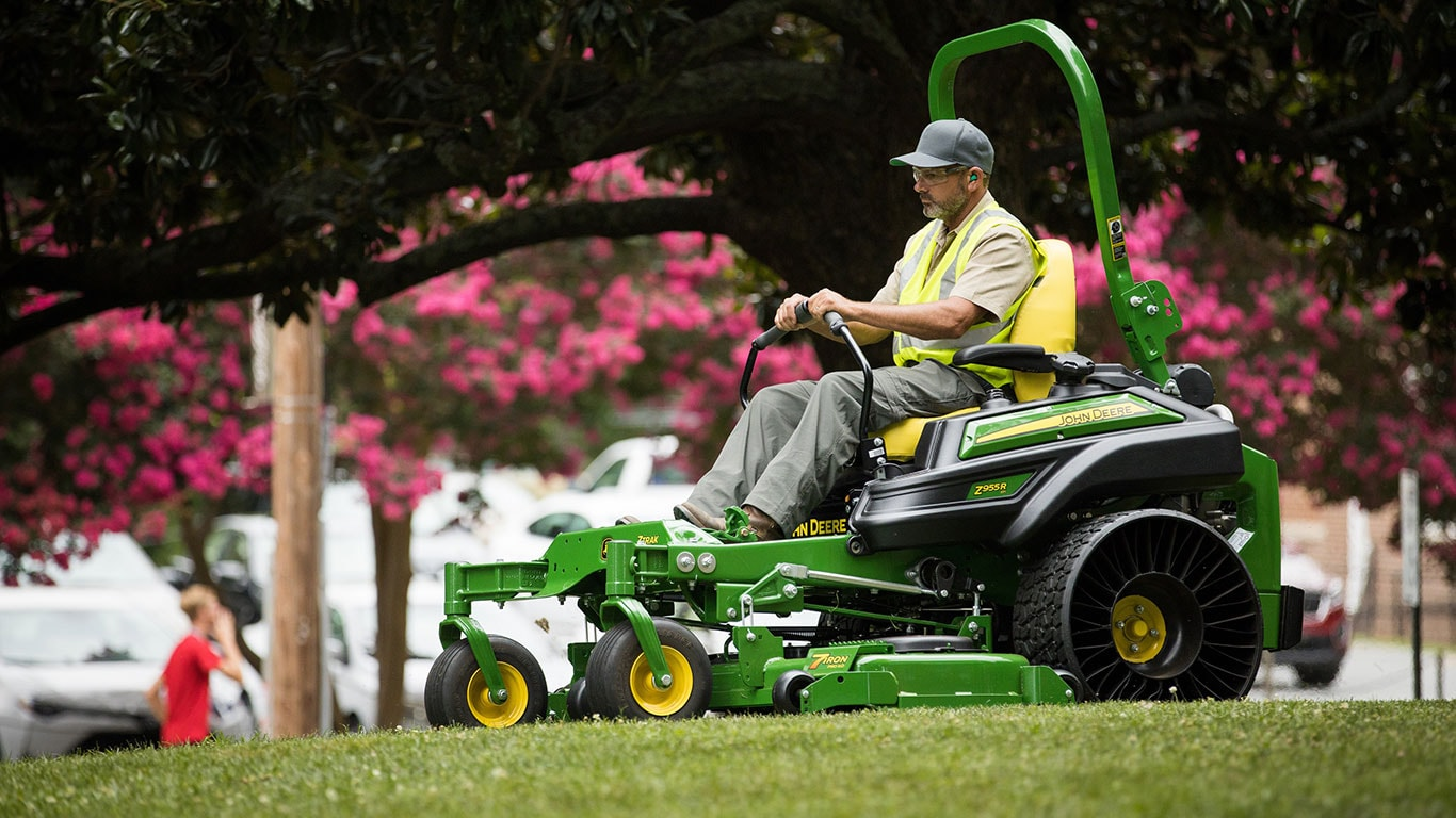 Man riding the new Z955R mower during spring time