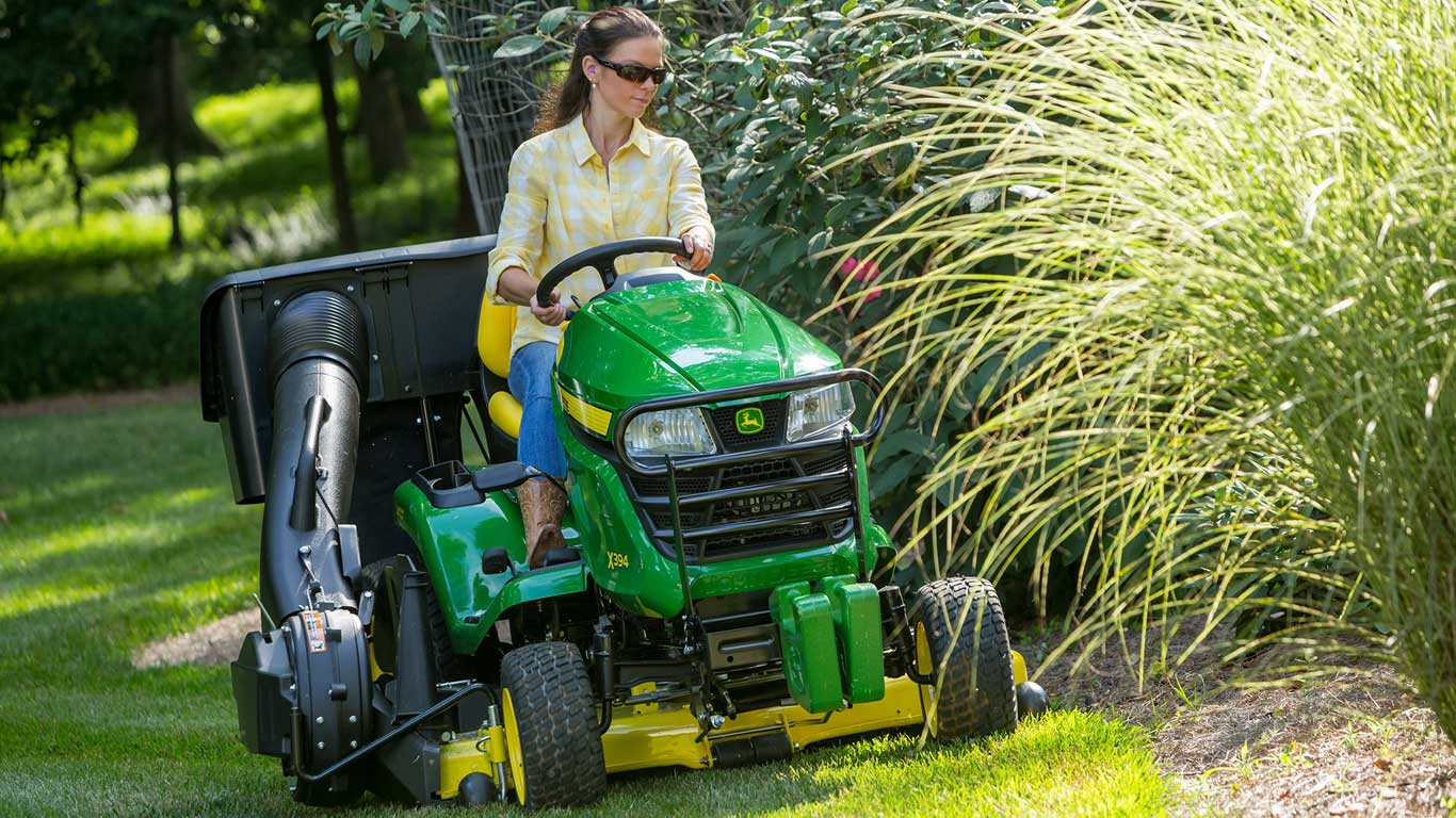 A woman mowing a lawn