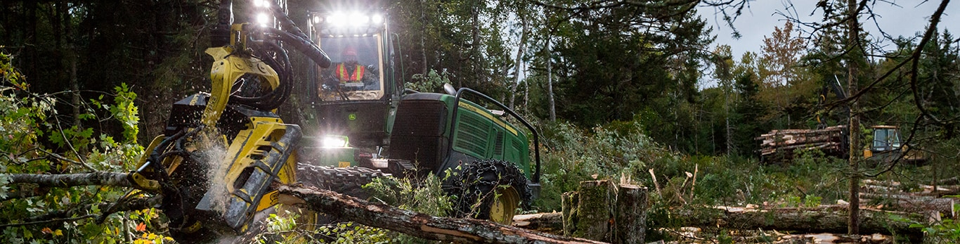H415 Harvesting Head on a 1270E Harvester in the woods