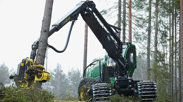 1470G 24.2-metric ton wheeled harvester model working in the forest