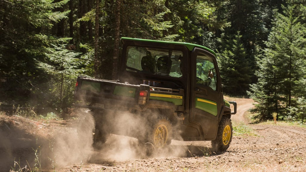 Gator™ XUV being driven through woods kicking up dust