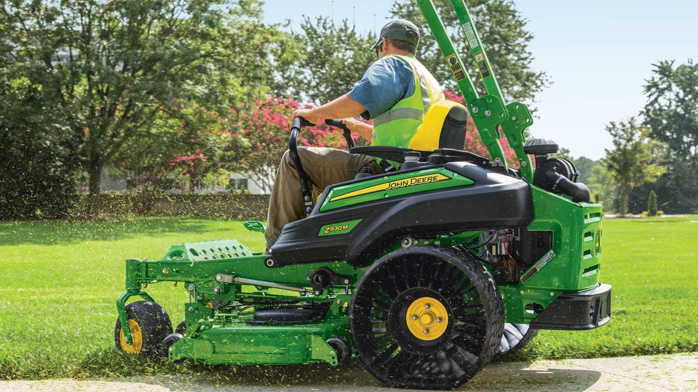 Man cutting grass with Z930M ZTrak™ mower.