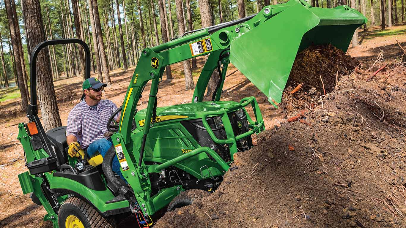 1 series tractor using front loader to dump soil