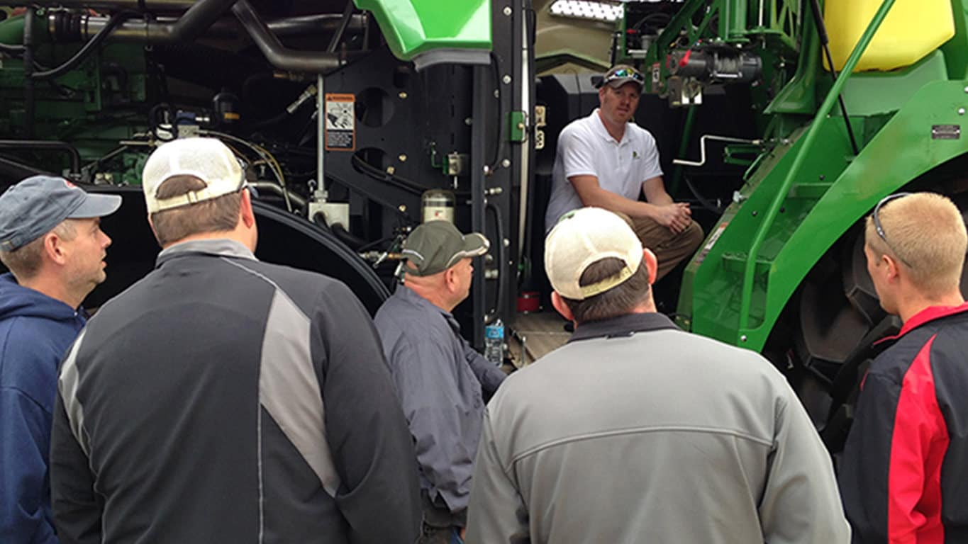 John Deere showing large ag equipment at farm show
