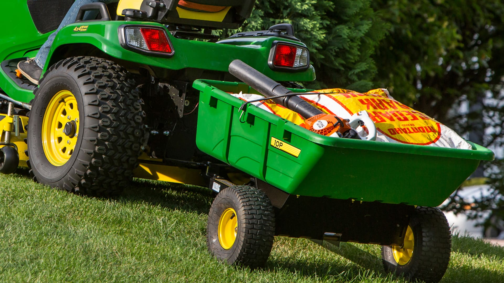 Closeup shot of lawn tractor pulling a cart