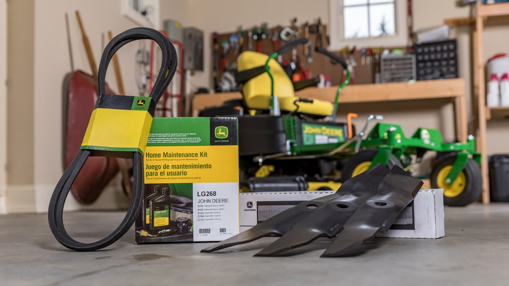 A Home Maintenance Kit sitting on a shop floor with a zero-turn mower in the background