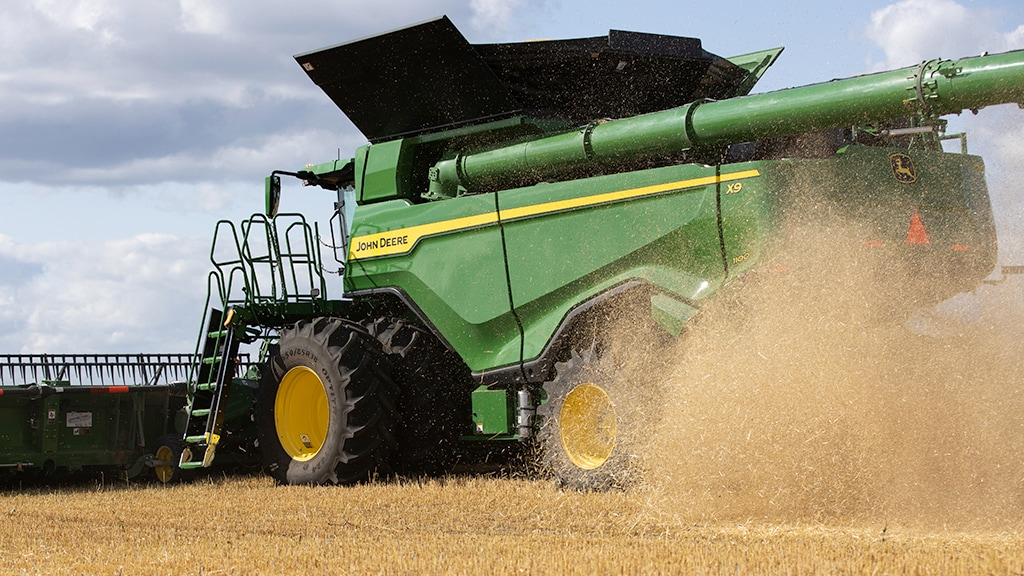 Photo of X9 Combine in the field.