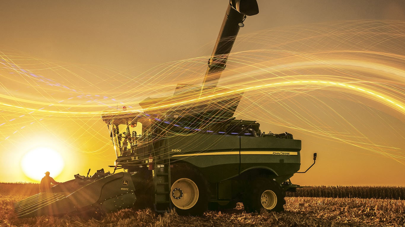 composite image of farm equip during at sunset/sunrise