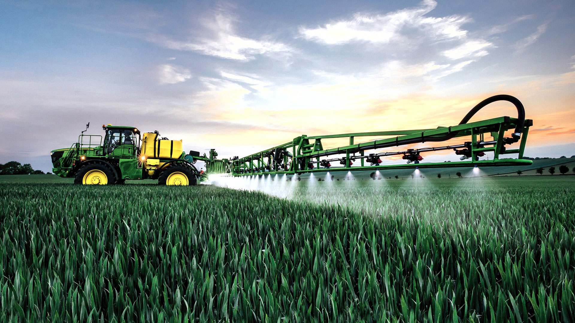 image of sprayer in crop field