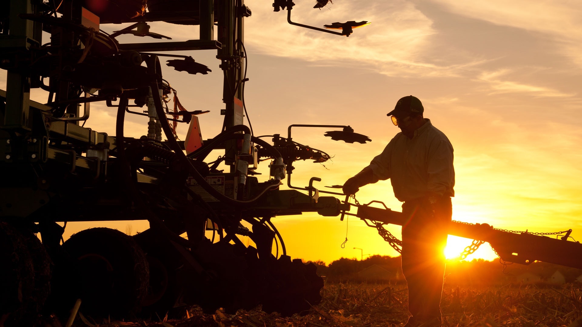 sunrise/sunset of sprayer equipment out in the field