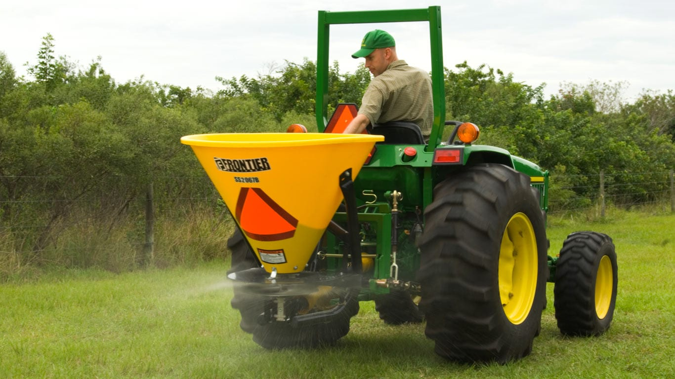 tractor with seeding attachment on in a field