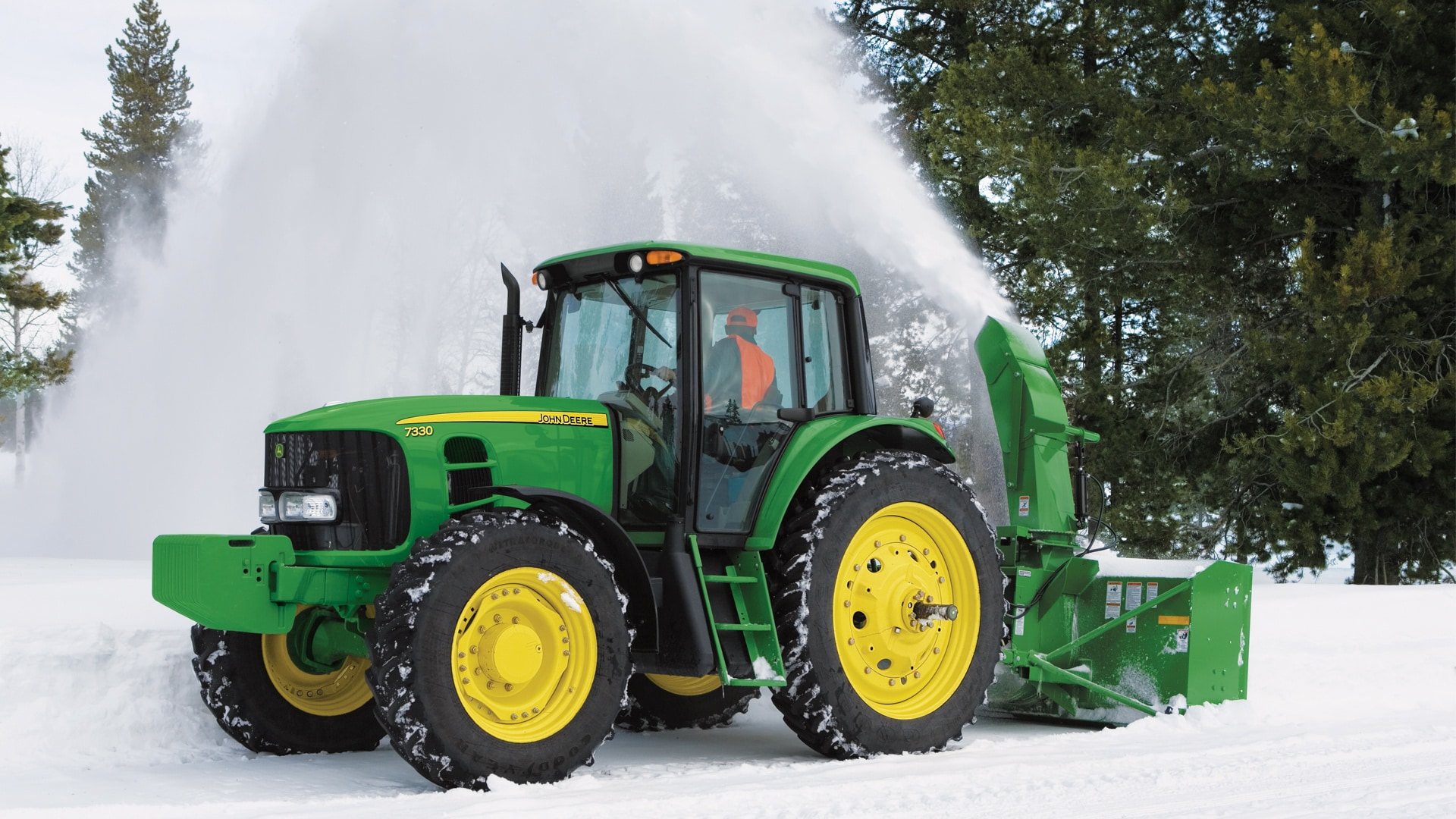 tractor with snow removal attachment in snow