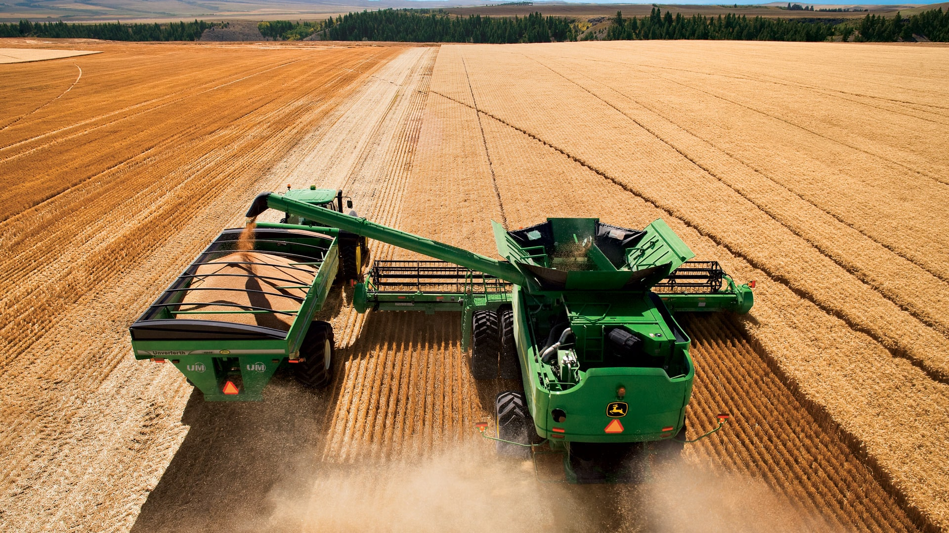 perfect balance found photo of combine in field