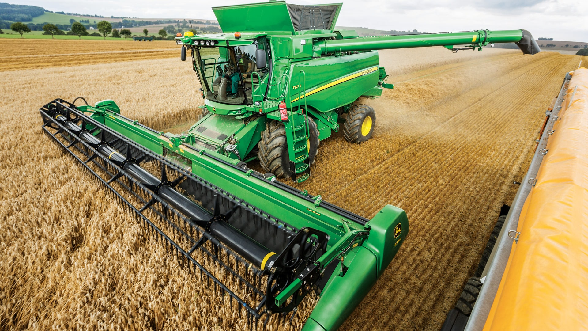 T Series Combine Moving through crops