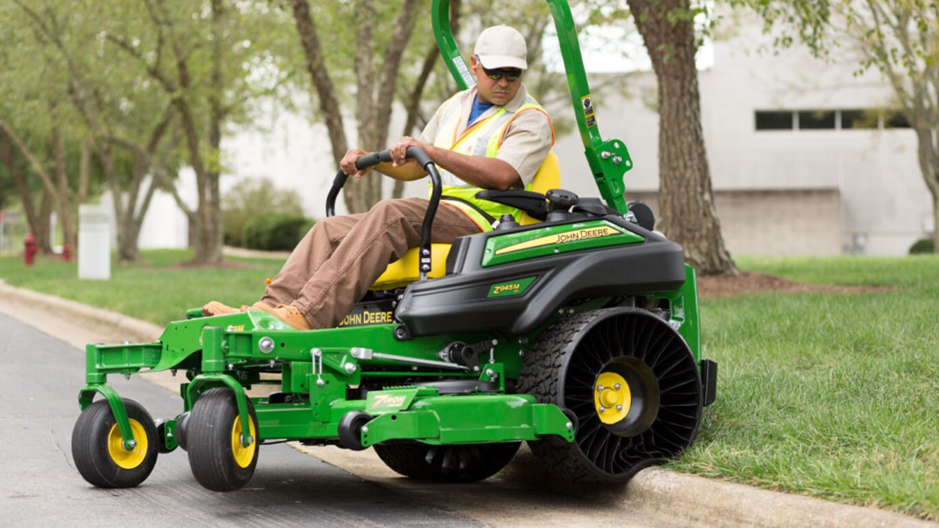 Z945M Commercial Ztrak Mower going over curb