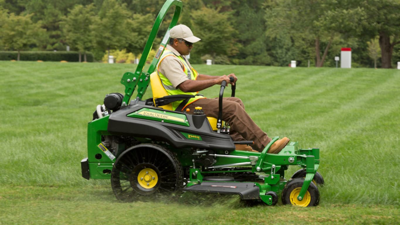 Man on Z945M Ztrak Commercial Mower